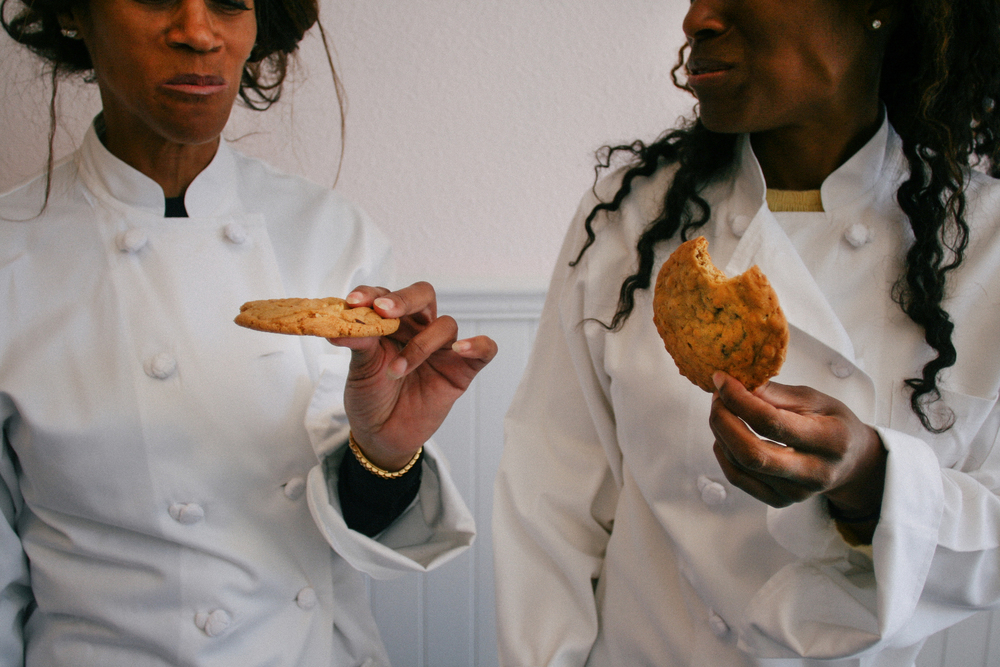 Sheila Harris-Young (left) and Toni Young (right), a mother and daughter cooking team, opened the cookie shop Bumzy's on Fillmore street to provide a space for community events and homemade cookies with a secret family recipe.