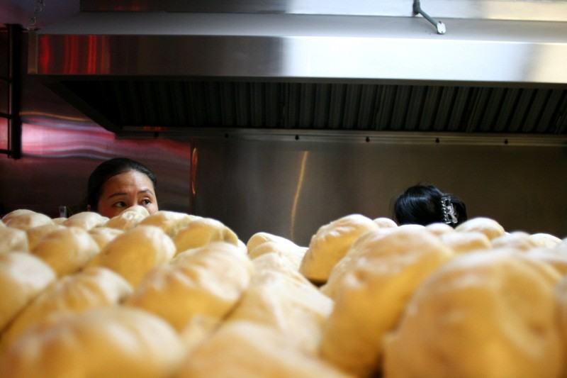 Chefs at Shan Dong Restaurant in Oakland serve up fresh bao.