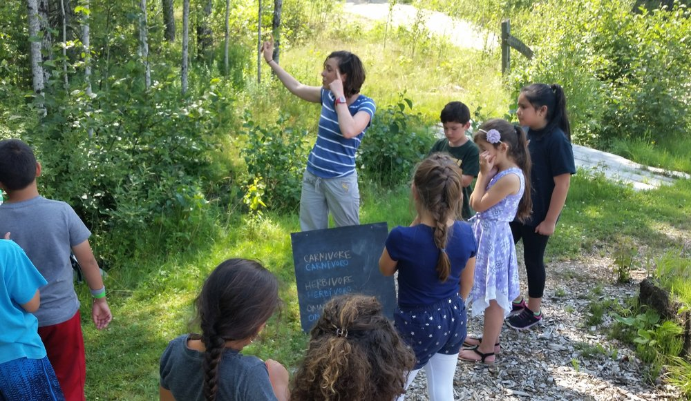 Ellie teaching about carnivores, omnivores, and herbivores at Blueberry Harvest School