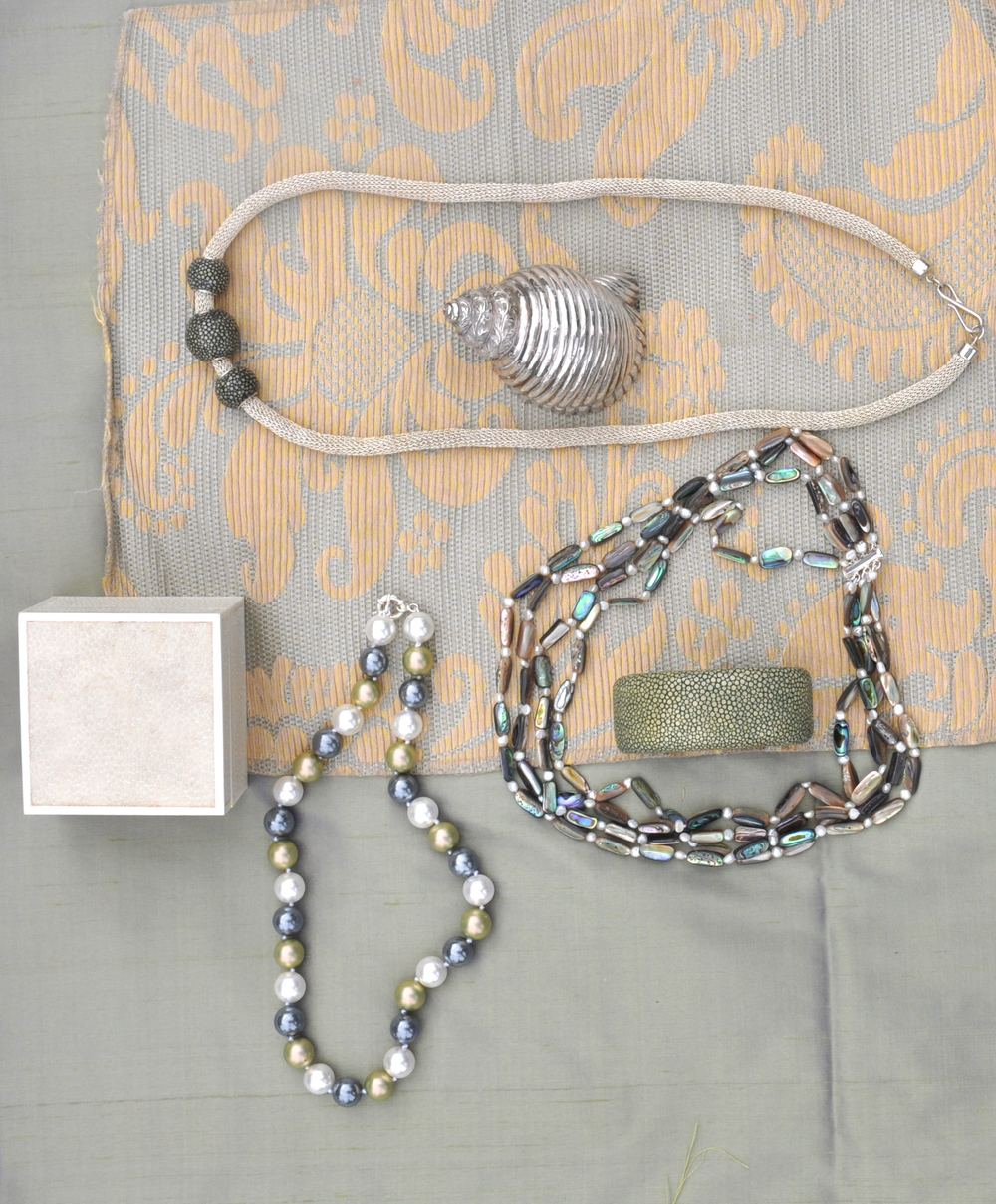 TOP LEFT: shagreen bead and silver mesh chain, CENTER: RIGHT: 4 strands abalone shell and freshwater pearls w/ shell clasp, shagreen cuff, BOTTOM LEFT-multi color pearl 20″ necklace w/ sterling clasp, shagreen box-special order