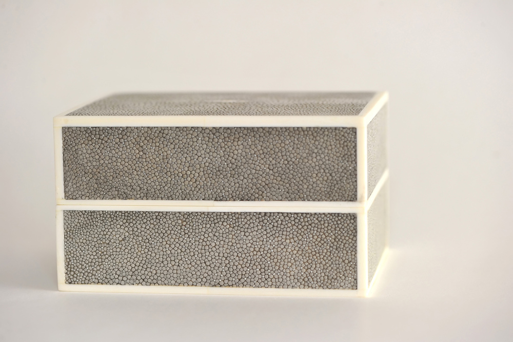 Slate Shagreen Box with Bone Detail- $510  Today shagreen is still used for the same sort of items as in the 17th and 18th centuries however many designers use faux shagreen instead since the material is quite expensive. Look at this handsome ottoman from Bunny Williams Home. She uses a faux shagreen on the center tray. What a perfect name, Tray Chic Ottoman!