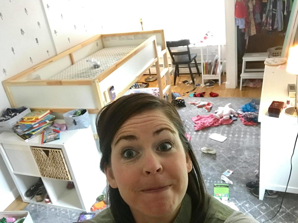 katie surrounded by kid clutter