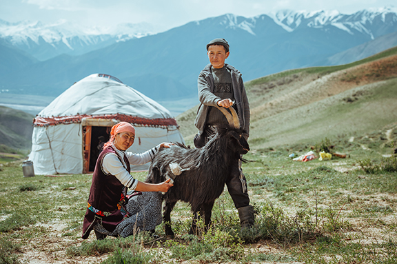 June Cashmere Photo Kyrgyz woman boy goat Lo Res.jpg