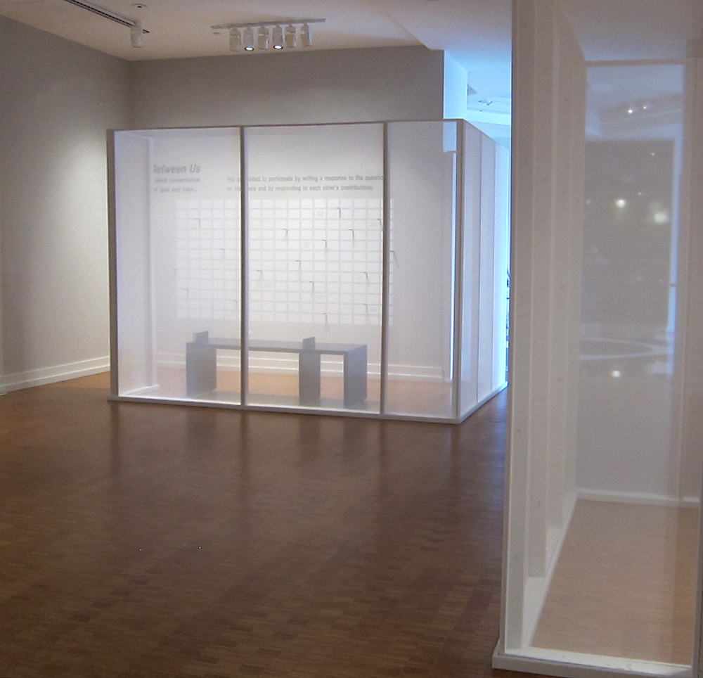 Between Us (left) and Social Blanket (right), Gallery of Contemporary Art 121, UCCS, Colorado Springs, Colorado, 2015 Jane Lackey: Points of Contact included site-specific installations bordered by semi-transparent scrim walls. Placed at opposite and diagonal sides of the middle gallery, the semi-private spaces for writing (Between Us) and drawing (Social Blanket) provided a collective interface for participants over the duration of the exhibition.