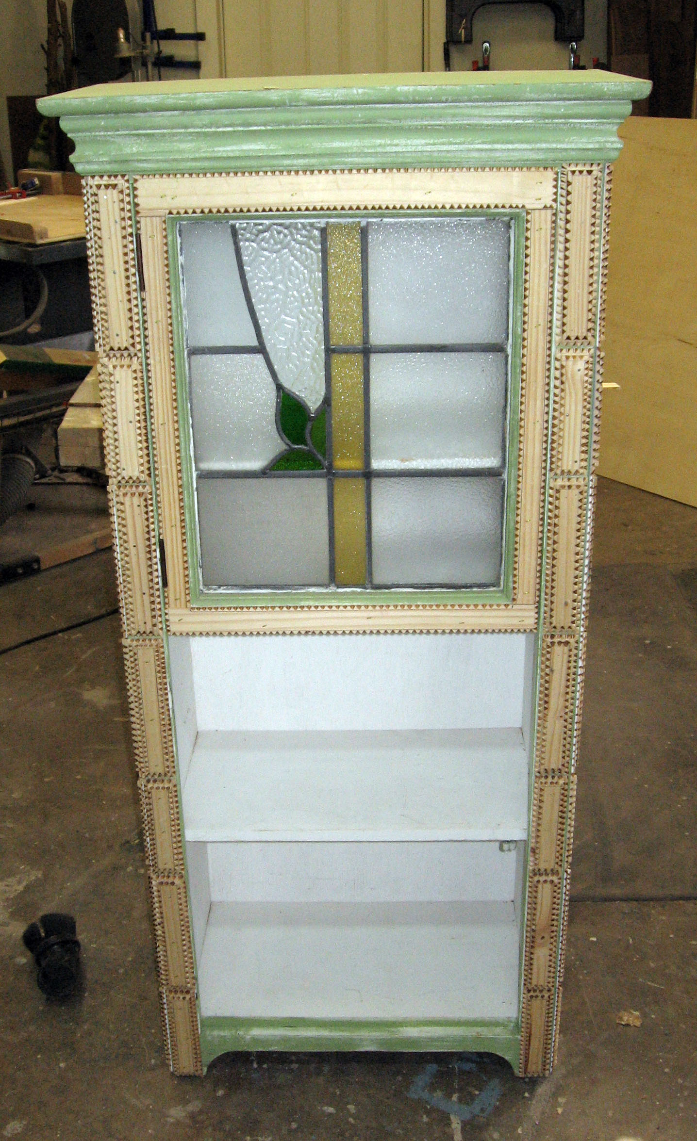 Beginning of stained glass tramp art cupboard