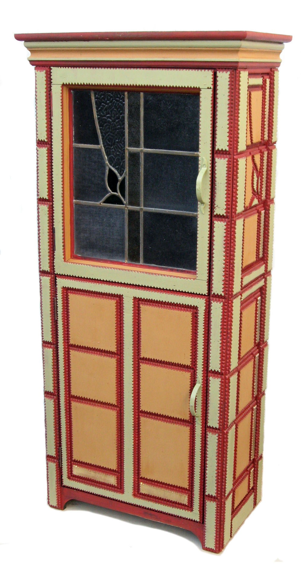 Tramp art cupboard with stained glass door.