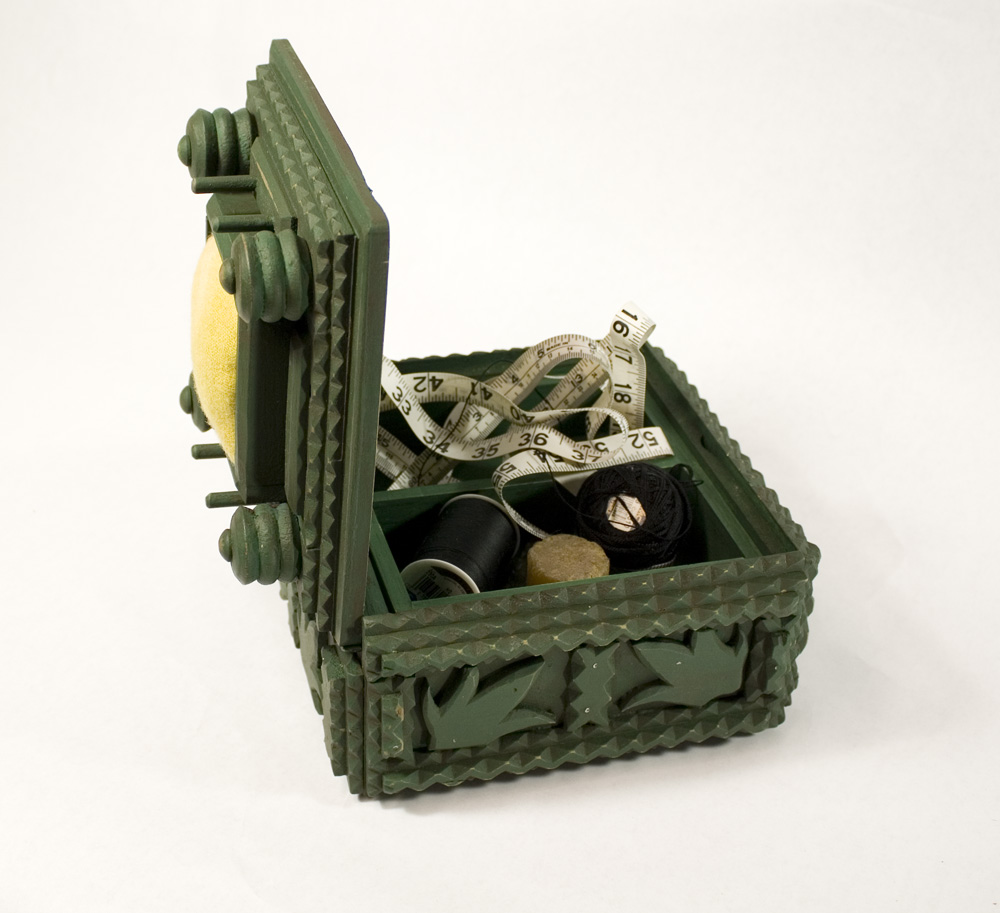Green tramp art sewing box with lid open