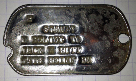 Dog tag for Scampy, found decades later in France.