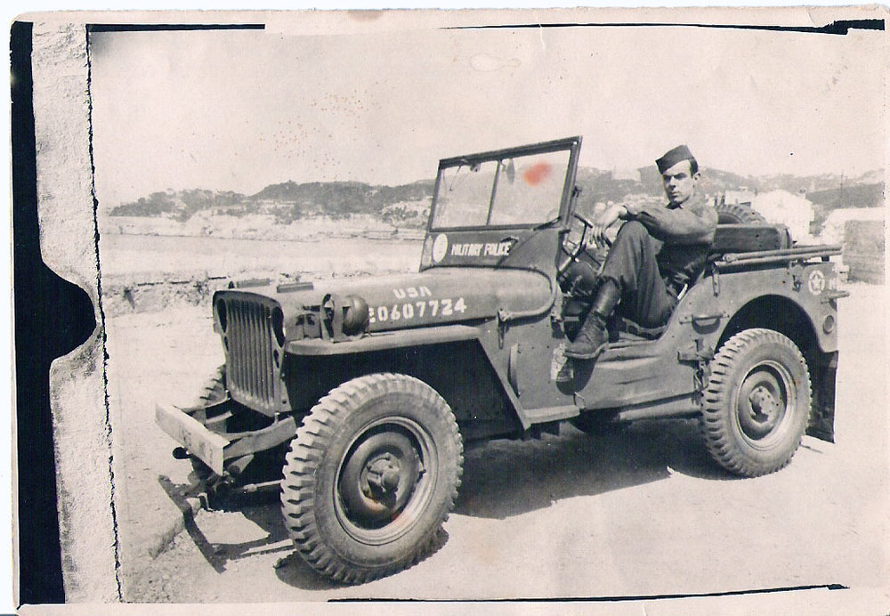Bob in jeep by coast.jpg