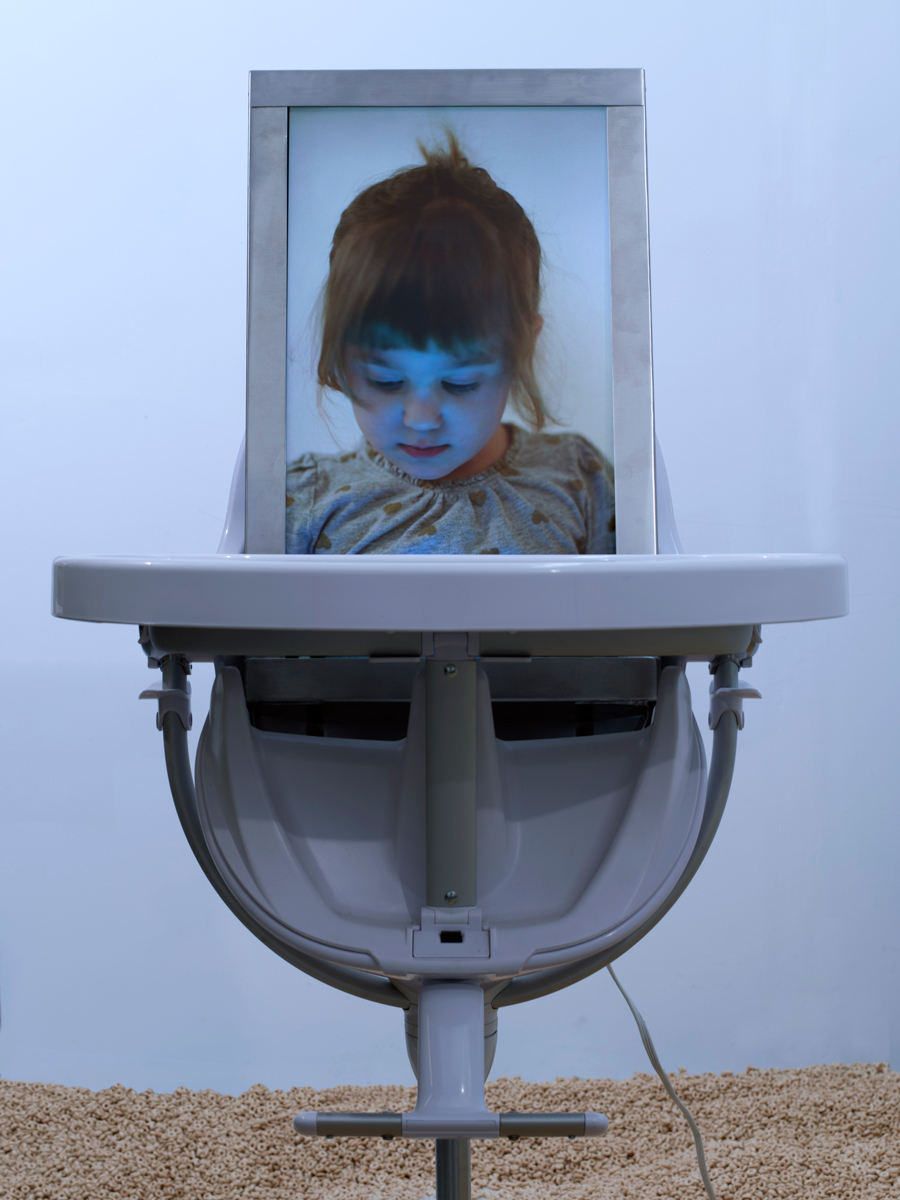 5-Hovnanian-Rachel-Lee_In-Loco-Parentis_2014_Installation-with-rear-projection-video-HD-video-acrylic-Cheerios-refridgerator-high-chair-metal-diamond-dust_Dimensions-Variable_Detail-View-1.jpg