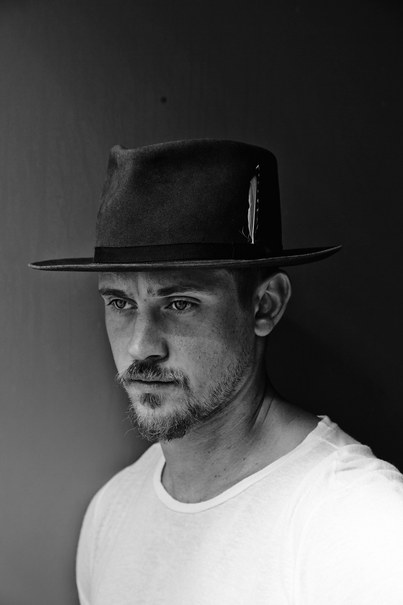 Boyd Holbrook  | FASHION CREDITS:  CALVIN KLEIN JEANS  t-shirt and talent's own hat.