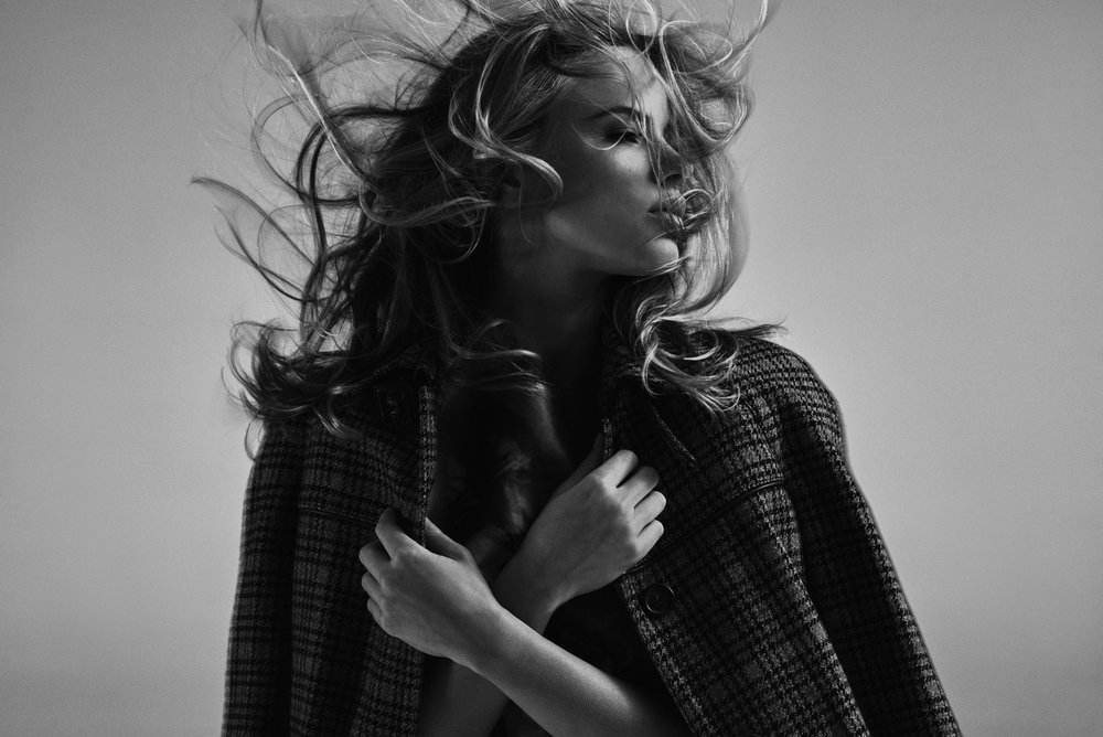 Halston Sage |  Photographed by Carlos Serrao |  Credits:  PRADA  coat