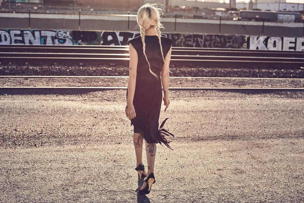 Bria wears PRADA dress and shoes.