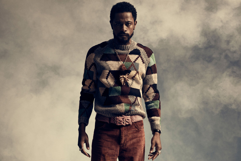 Lakeith wears PRADA sweater, pants, belt, and necklace.