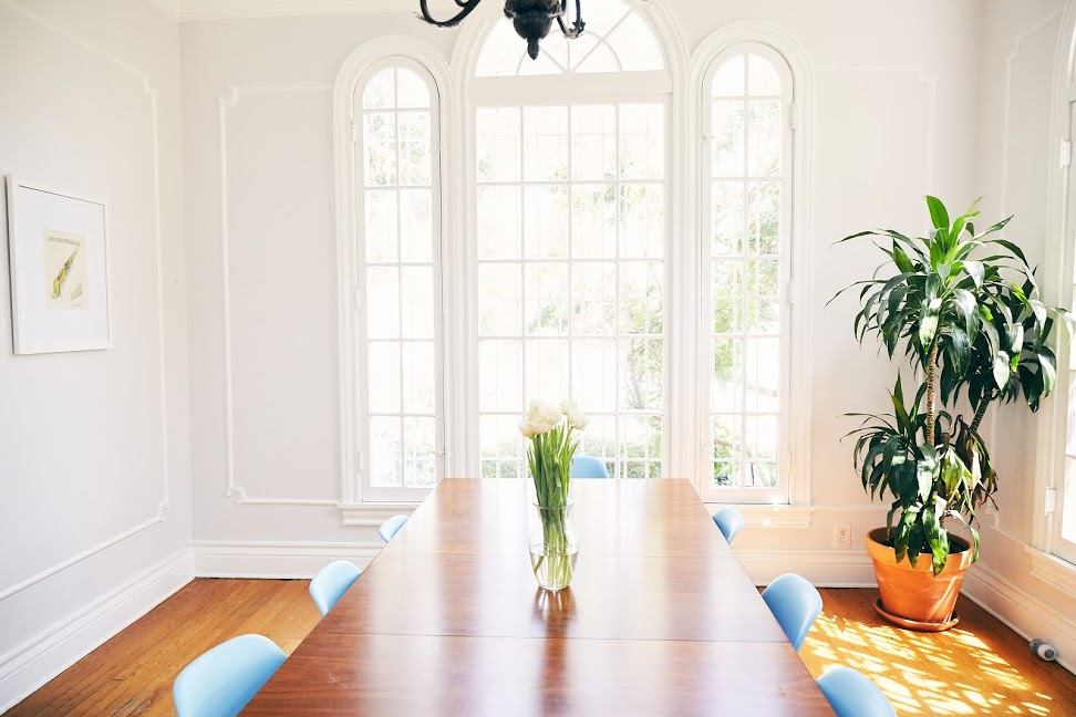"""When we walked into this room, we knew it was the house for us. We fell in love with the tall ceilings, crown molding and the big windows. The room gets a lot of natural light and is great for hosting dinner parties."""