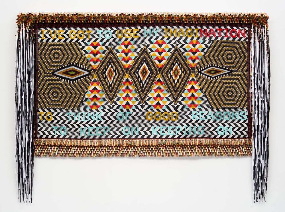 "Jeffrey Gibson. ""TO MY NATION"" (2017). Glass beads, artificial sinew, trading post weaving, metal studs, copper and tin jingles, nylon fringe, acrylic felt, canvas, wood.70 x 91 INCHES."