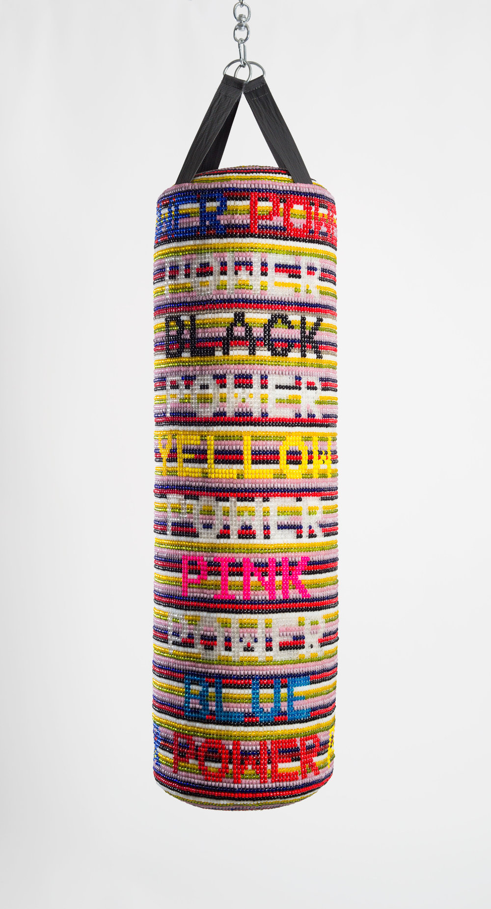 "Jeffrey Gibson. ""POWER POWER POWER"" (2017). Repurposed vinyl punching bag, glass beads, artificial sinew, acrylic felt.51 x 12 INCHES."