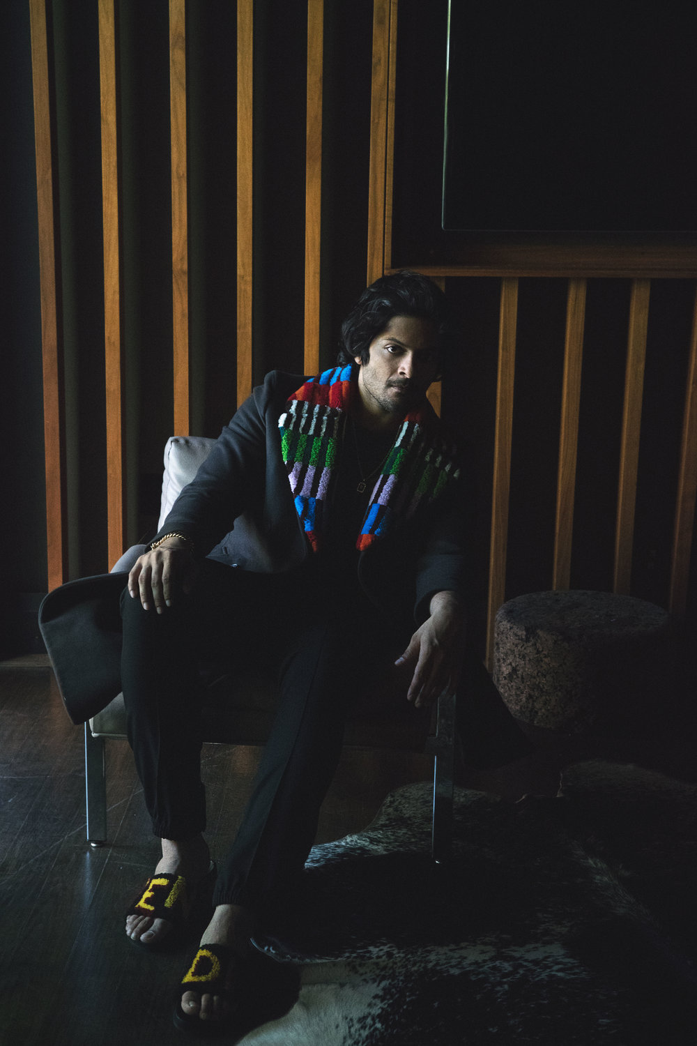 Ali Fazal | all images by Mitchell Nguyen   McCormack  | Credits: FENDI  coat, t-shirt, and shoes,  DIOR  pants, and  REGIME NY  necklace