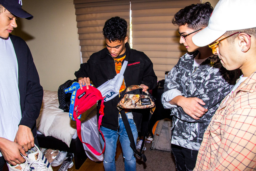 """Edwin's a self proclaimed """"fanny pack fanatic."""" He loves to match a fanny pack to every outfit."""