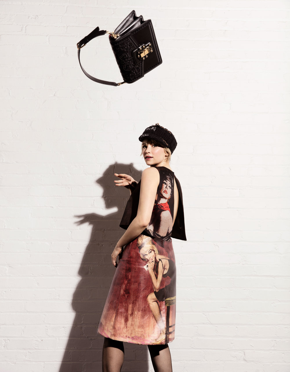 PRADA top, skirt, and hat, WOLFORD tights and DOLCE & GABBANA bag.