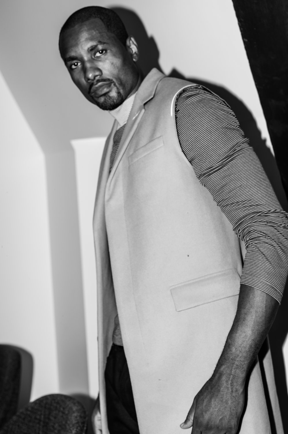 Serge Ibaka | all images by Bil Brown | FASHION CREDITS: Vest by DIOR HOMME, Sweater by SALVATORE FERRAGAMO, and Serge's own jeans