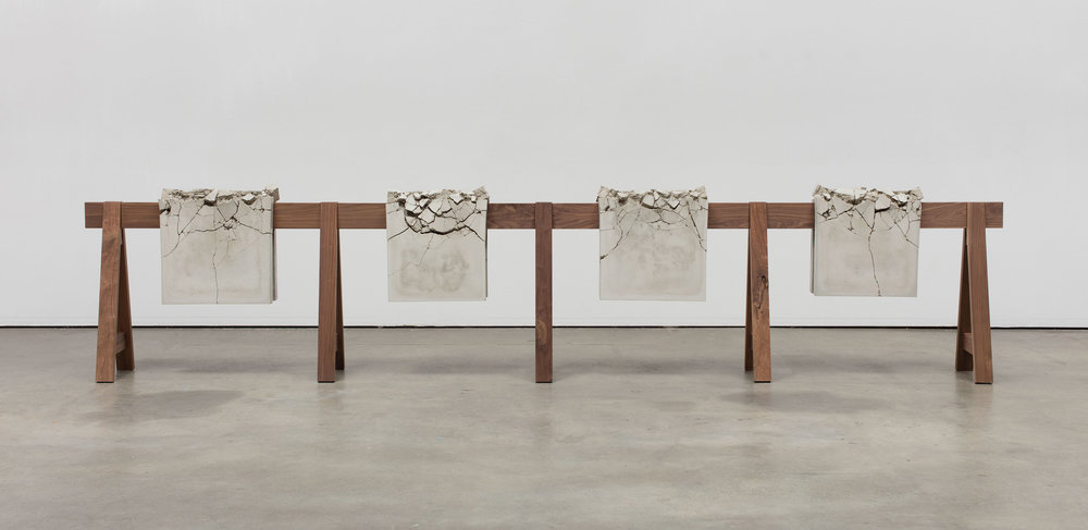 "Analia Saban. ""Draped Concrete"" (2016). Four concrete slabs on wooden sawhorse. 104,8 x 487,7 x 42,9 41 CENTIMETERS. 1/4 x 192 x 16 7/8 INCHES Courtesy the artist and Sprüth Magers Photo: Brian Forrest"