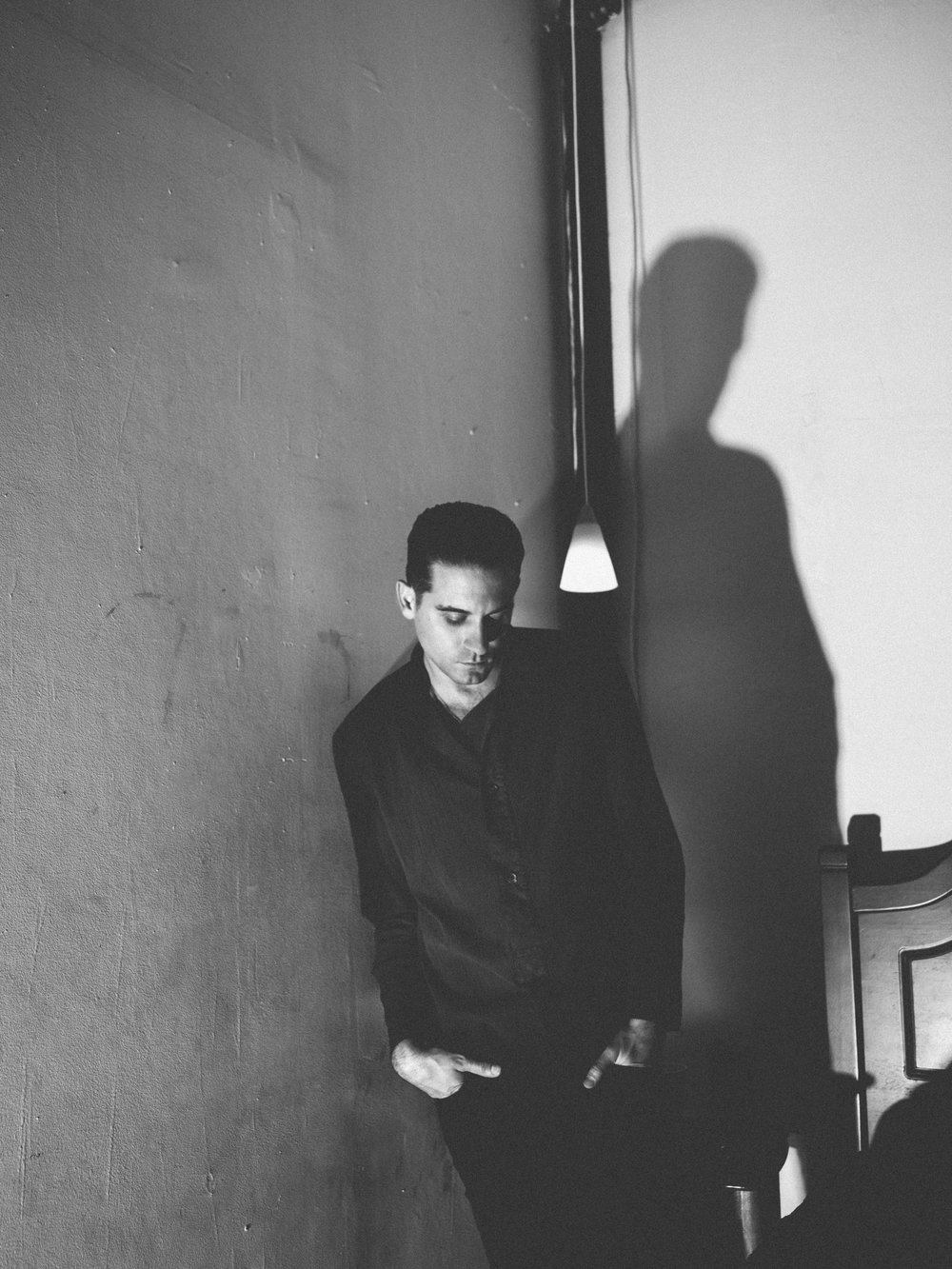 G-Eazy |  all photos by   Shane McCauley | Fashion credits:  ISSEY MIYAKE  shirt,  GUESS  pants,  SAINT LAURENT BY ANTHONY VACCARELLO  belt, and  CHROME HEARTS  necklace.
