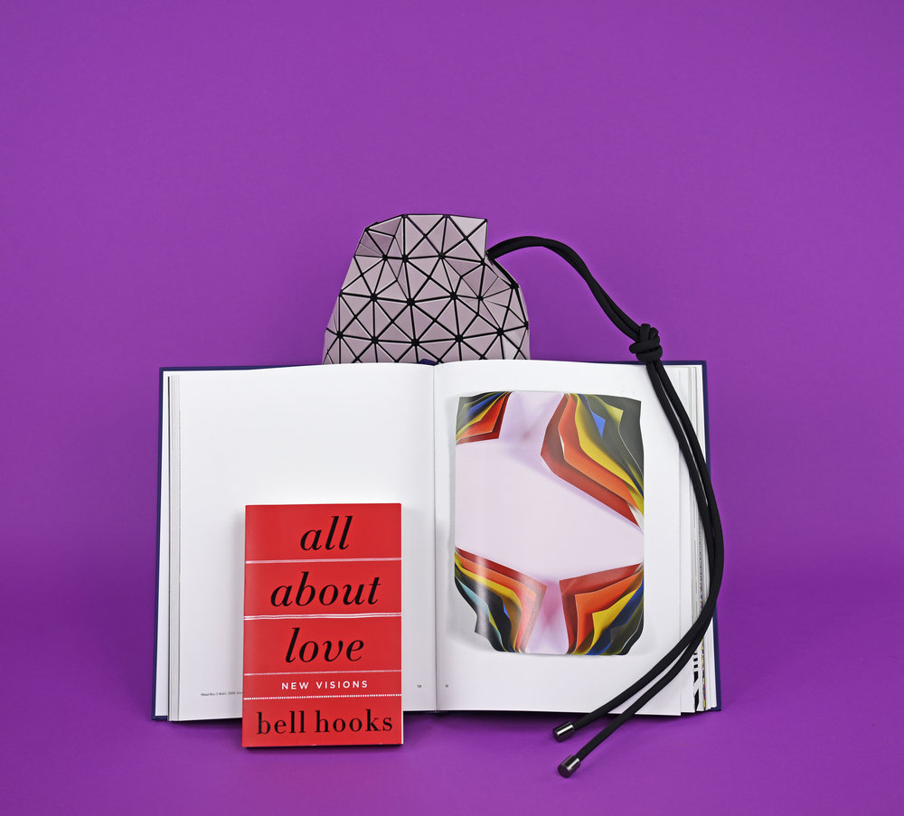 Bell Hooks,  All About Love , $15.99.  Jim Lambie art book , $75.00. Issey Miyake Bao Bao,  Wring Shoulder Bag , $1,695.00.