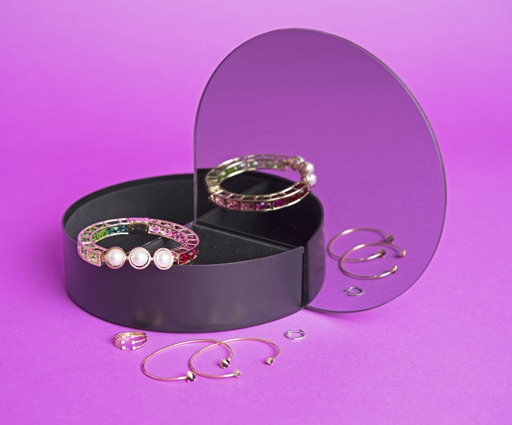 AYTM,  Black Mirror Jewelry Box , $115.00.Atelier Swarovski Mary Katrantzou,  bracelet . Jenni Kwon Designs,  Stacked Diamond Cuff Ring , $1,655.00.Jenni Kwon Designs,  Onyx White Diamond Cuf f, $836.00.Jenni Kwon Designs,  Black Diamond Cuff , $981.00. The Last Line,  Medium Rainbow Huggie Earring , $219.00.
