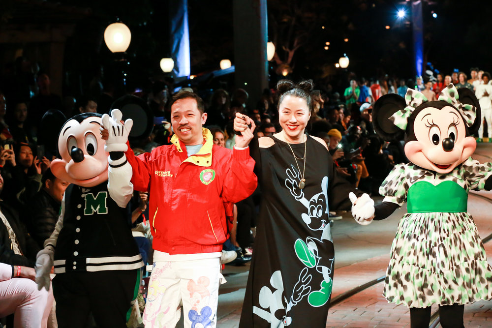 Humberto Leon and Carol Lim taking a bow with Mickey and Minnie Mouse