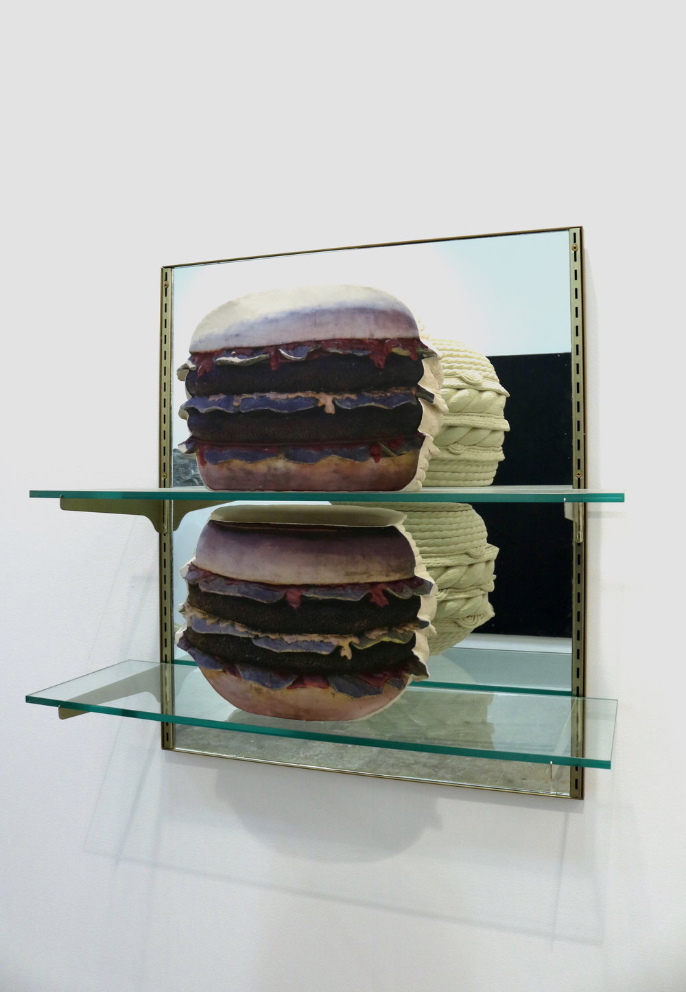 Double Double Double  (2017). Ceramic, glaze decals, mirror, brass hardware, and glass. 30 x 25 x 11 inches