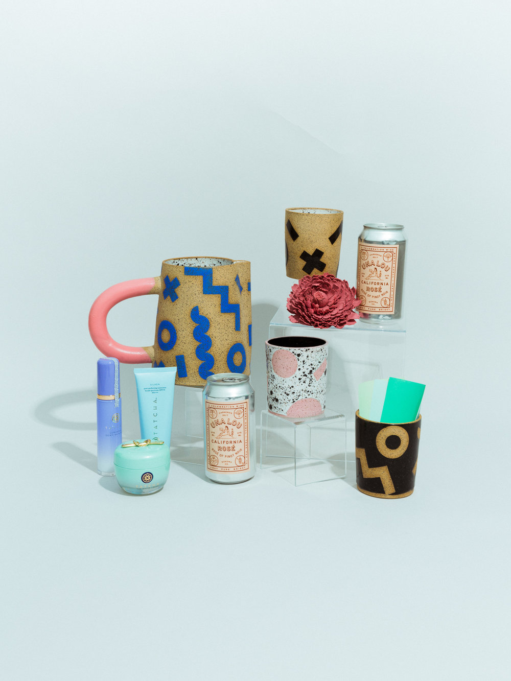 TATCHA  cleanser, cream, and serum,  RECREATION CENTER  ceramic pitcher and tumblers,  LOEWE X WILLIAM MORRIS  brooch available at Matchesfashion.com, and  UNA LOU ROSÉ  wine.