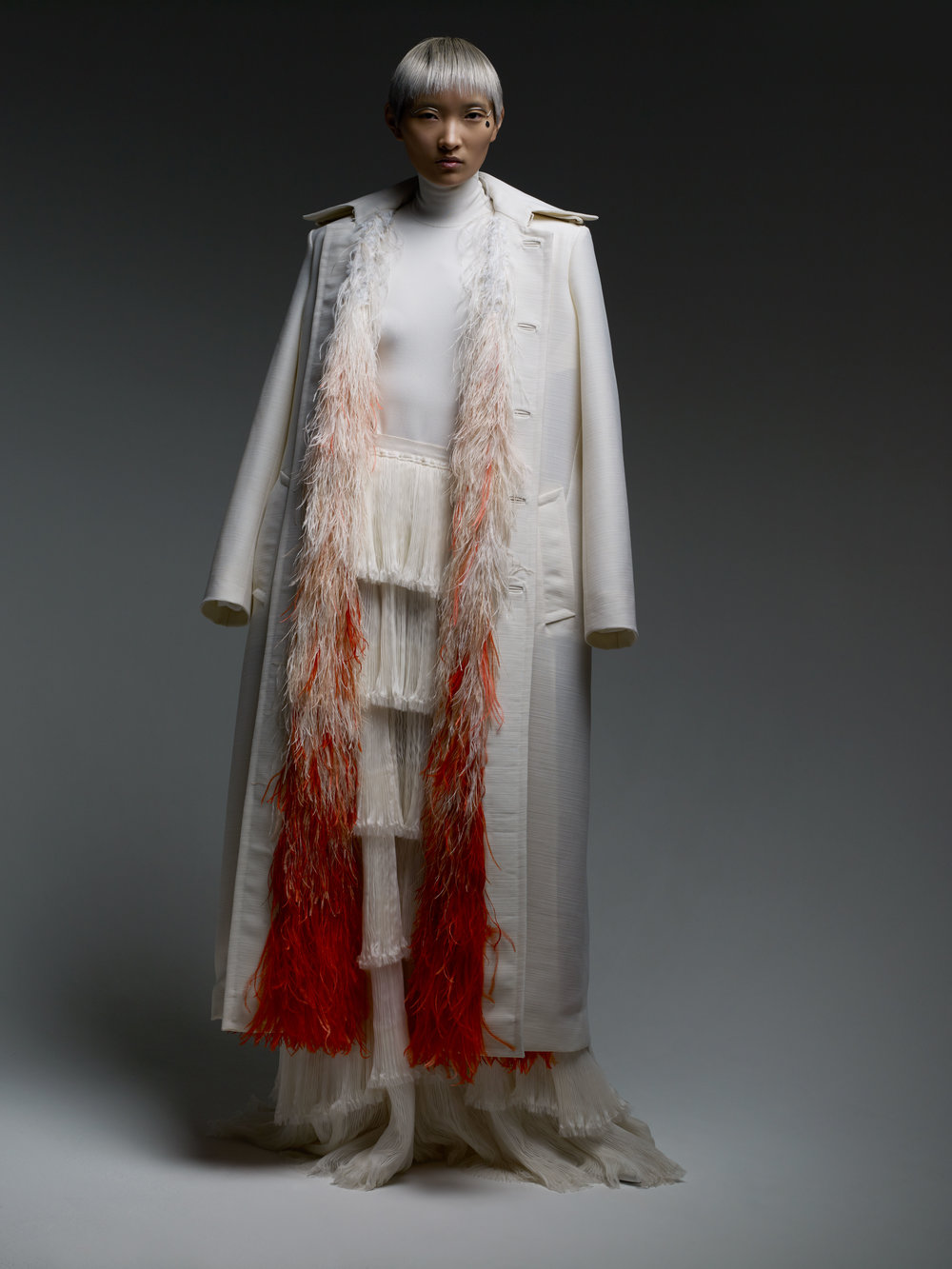 GIVENCHY HAUTE COUTURE coat, bodysuit, and skirt.