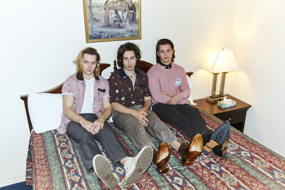 Left to right: Michael wears  FENDI  shirt,  HUDSON JEANS  t-shirt,  ETRO  pants,  CONVERSE  shoes. Matt wears  FENDI  shirt and pants and  BRUNO MAGLI  shoes. Mark wears  FENDI  sweater,  ETRO  pants, and  BRUNO MAGLI  shoes.