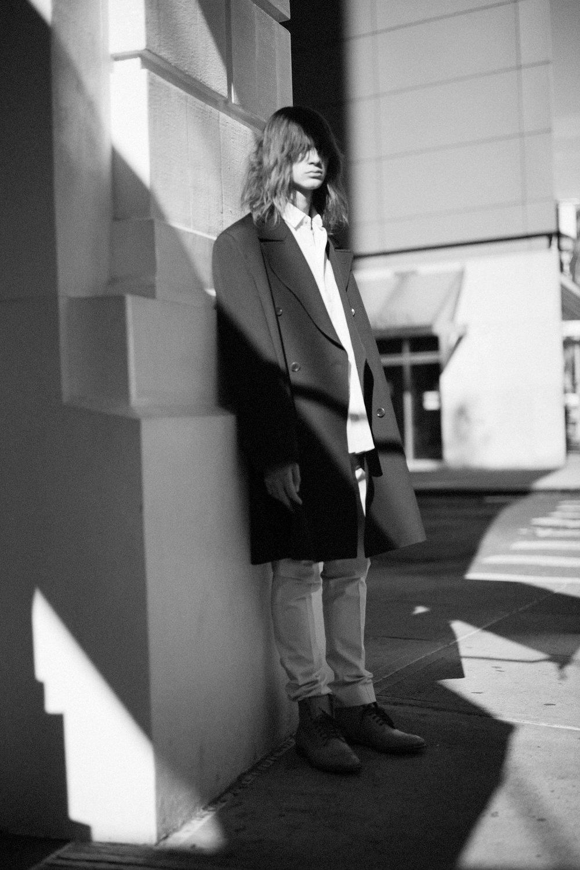 DRIES VAN NOTEN coat, BERLUTI shirt and pants, and FLORSHEIM shoes.