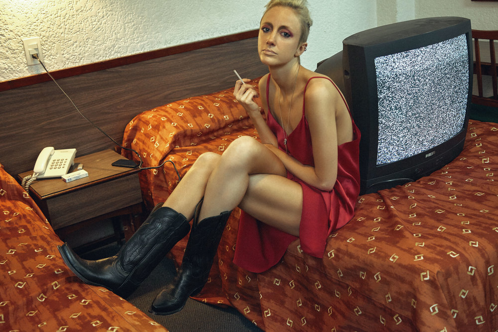 SALVATORE FERRAGAMO dress and talent's own boots and necklace. Hair & Makeup: Torsten White Photographed at Hotel Mallorca