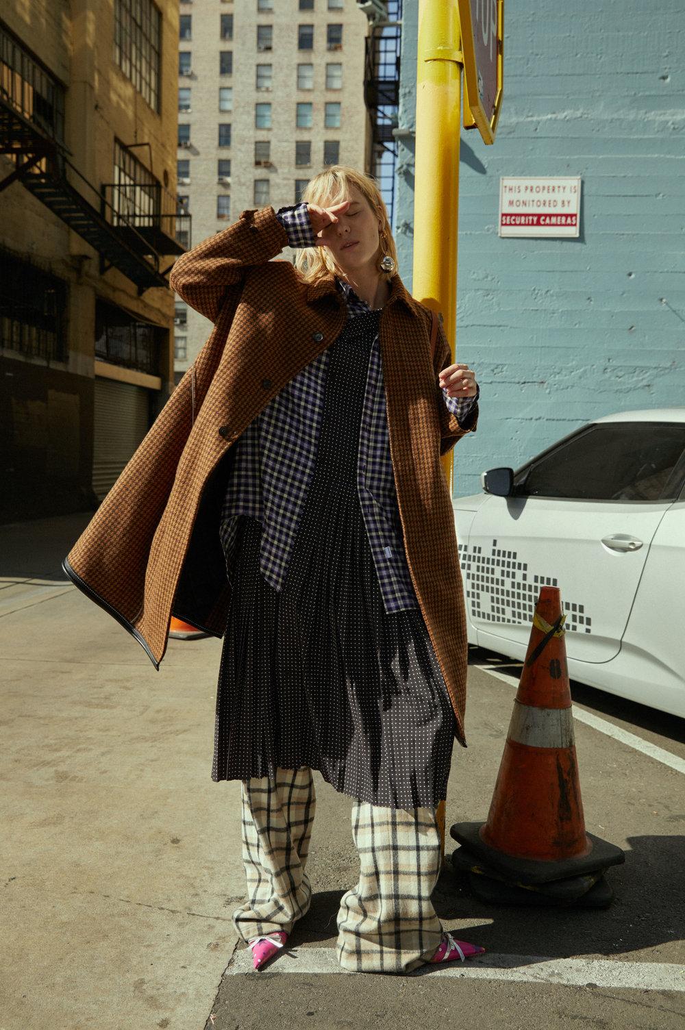 BALENCIAGA coat, dress, shirt, shoes, and earrings.
