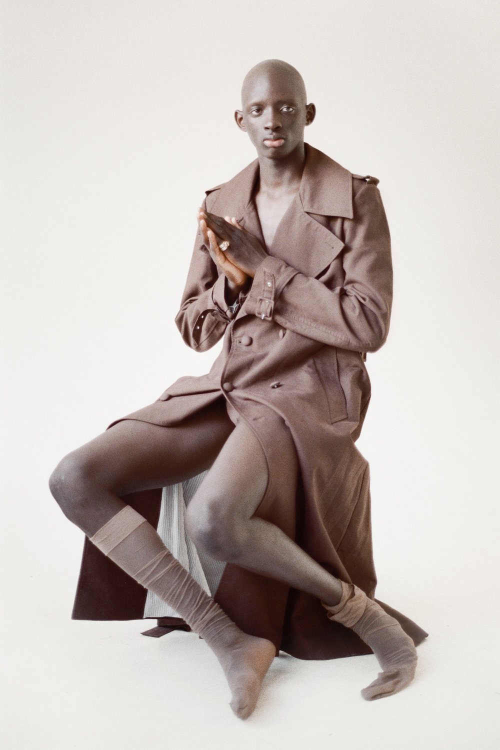 ERNEST W. BAKER  trench,  NICOLA INDELICATO  brief,  WOLFORD  socks, and  ZELDA PASSINI  ring.