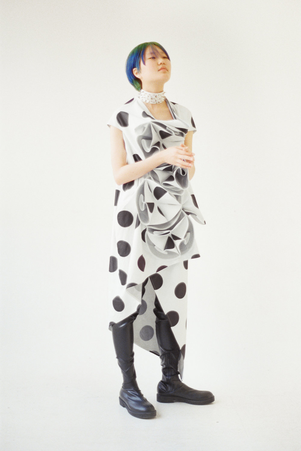JUNYA WATANABE  dress, boots, and necklace.