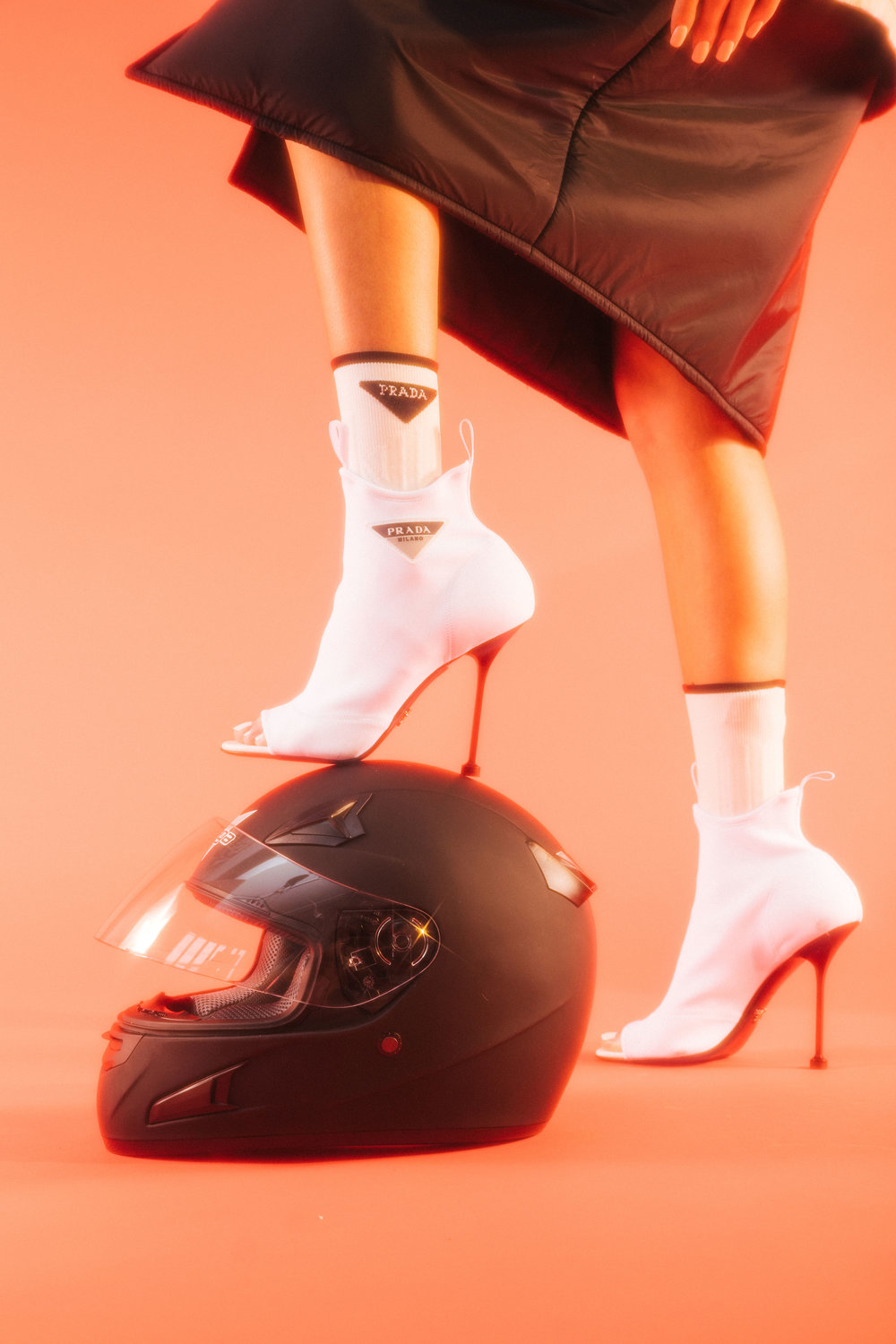 PRADA  jacket, socks, and shoes, and stylist's own helmet.
