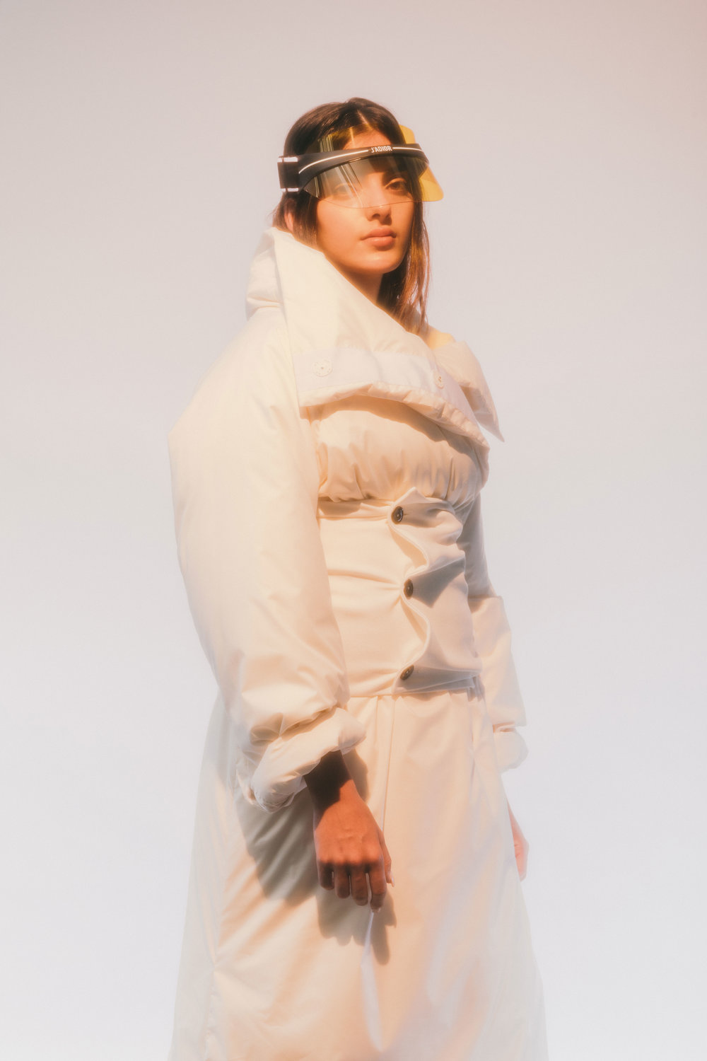 JIL SANDER  coat and corset belt and  DIOR  visor.