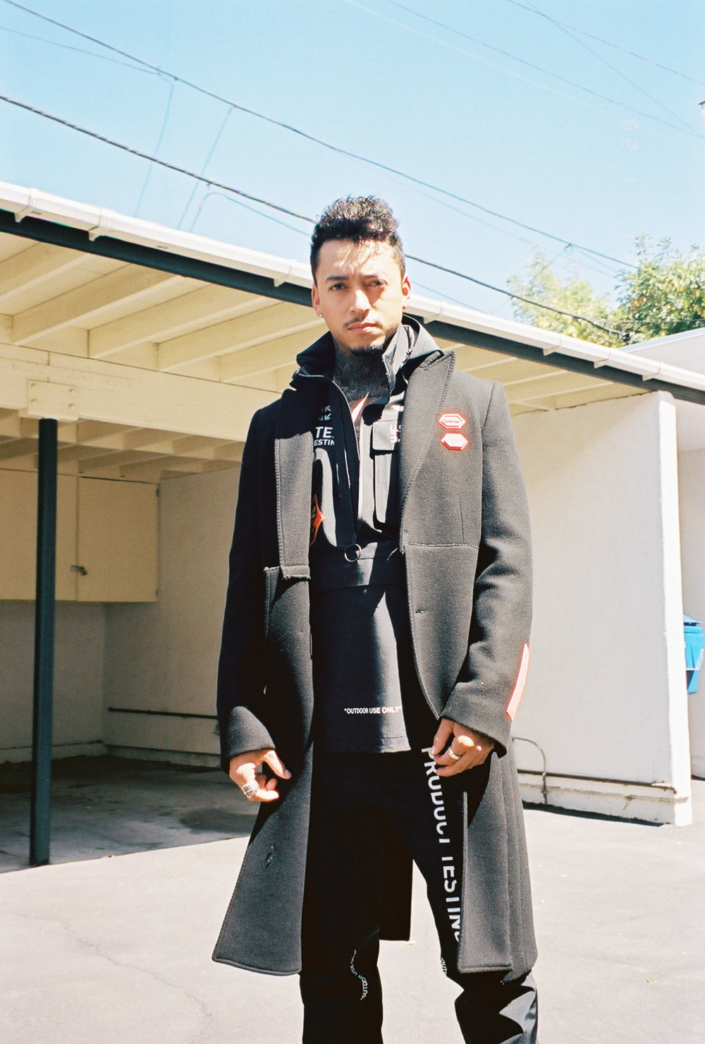 OFF-WHITE C/O VIRGIL ABLOH coat, jacket and pants, and  CHROME HEARTS  rings.