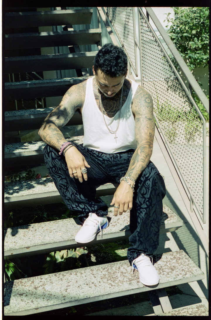 BASSIKE tank top, DIOR HOMME trousers, NIKE shoes, CHROME HEARTS  necklace, bracelets, and rings, and talents own necklace and bracelet.