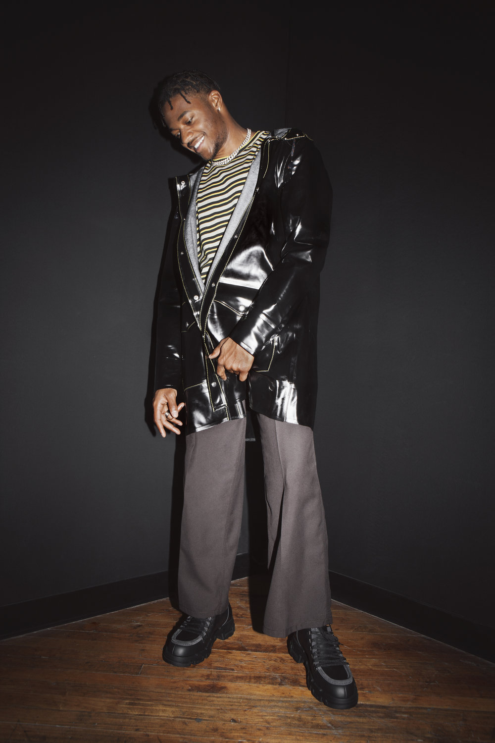 MARNI  Jacket ,  shirt , and  pants  ,    LANVIN  shoes , and Talent's own Jewelry.