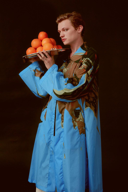 Turner  wears   DRIES VAN NOTEN     coat.   PUIFORCAT     Etchea art deco 1937 tray.