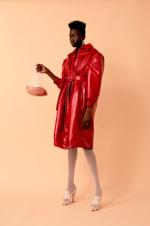 Nya  wears   MIU MIU     coat,   CHRISTIAN LOUBOUTIN     shoes,   MODERN WEAVING     earrings, and stylist's own tights.