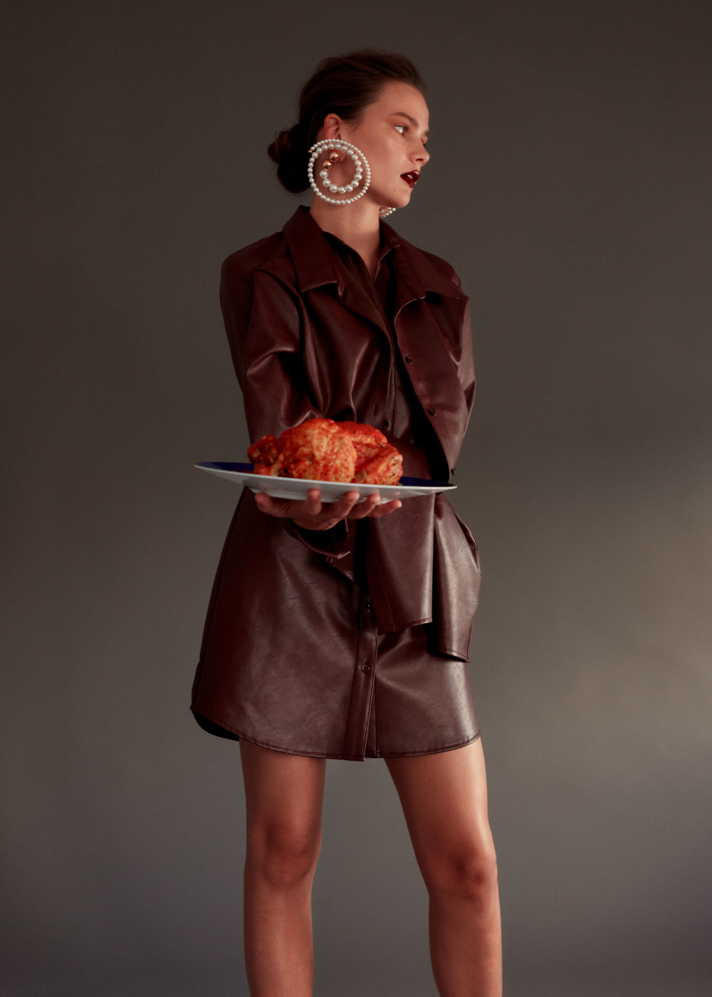 """Jane  wears   Y/    PROJECT       dress and earrings available at Please Do Not Enter.   HERMÈS     """"Bleus D'Ailleurs"""" presentation plate."""