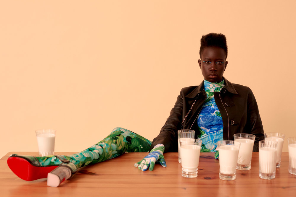 """Nya  wears   HERMÈS     coat,   RICHARD QUINN     top and leggings both available at MatchesFashion.com, and   CHRISTIAN LOUBOUTIN     shoes.   ATE VAN APELDOORN  Simple Pine Table  available at Amsterdam Modern and   BACCARAT     """"Perfection"""", """"Harmonie"""", and """"Béluga"""" Highball glasses."""