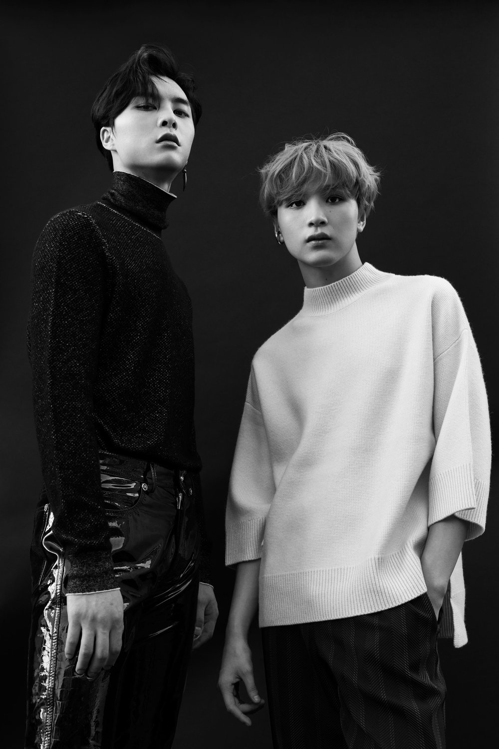 Left to right: Johnny wears   BOTTEGA VENETA     sweater,   VERSACE     pants, and his own earring. Haechan wears   BALDWIN     sweater and pants and   PORTRAIT REPORT     earring and   HERMÈS     pants.