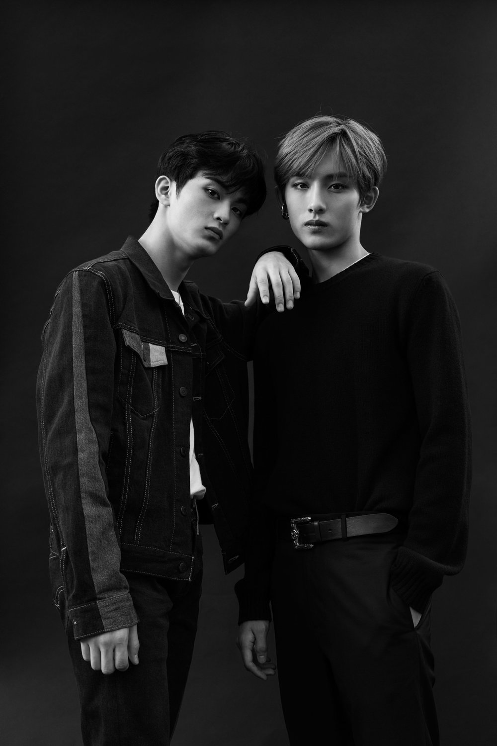 Left to Right: Mark wears his own jacket, shirt, and pants. WinWin wears   BOTTEGA VENETA     sweater,   VALENTINO     pants,   PORTRAIT REPORT     earring, and his own belt.